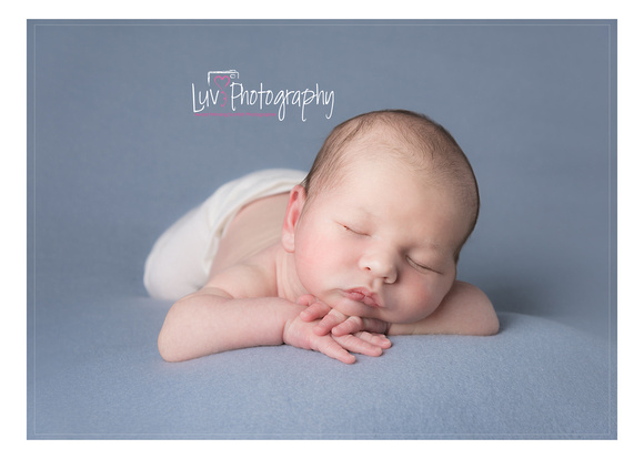 Newborn Baby in hands Safety and trained photographer